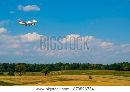 Zurich, Switzerland - July 19, 2018: Swiss airlines airplane preparing for landing at day time in international airport