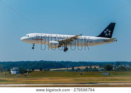 Zurich, Switzerland - July 19, 2018: Star alliance airlines airplane preparing for landing at day time in international airport