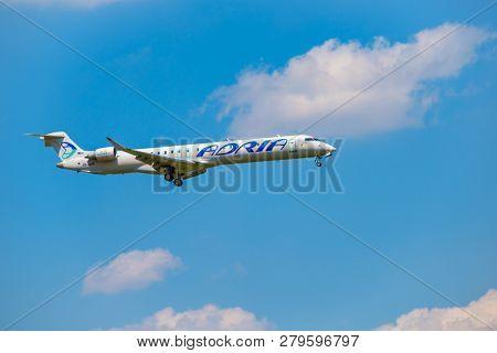 Zurich, Switzerland - July 19, 2018: Adria airlines airplane preparing for landing at day time in international airport