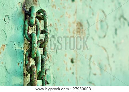 Chain At A Steel Door On An Abandoned Company Site