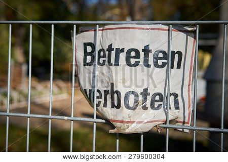 Sign On A Fence With The Inscription