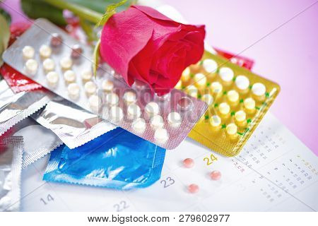 Contraceptive Pill And Condom Prevent Pregnancy Contraception Valentines Safe Sex Concept / Birth Co