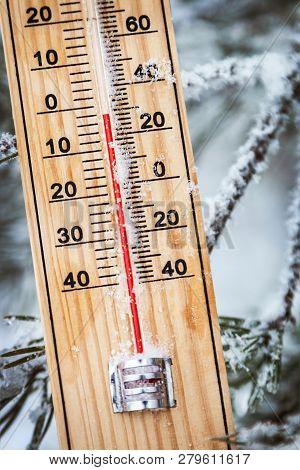 Thermometer With Subzero Temperature Stuck In The Snow In The Winter