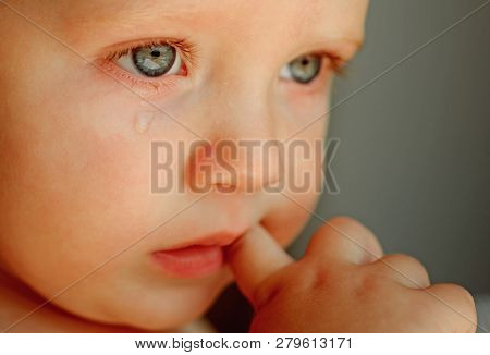 Feeling Weepy. Baby With Tear Rolling Down His Cheek. Little Boy Child With Sad Face. Little Baby Cr