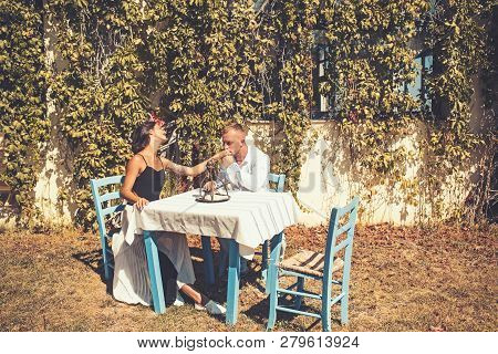 Proposal And Marriage Concept. Couple In Love At Outdoor Cafe. Man Kiss Hand Of Girl In Restaurant.