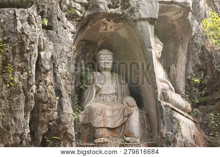Ancient stone statue of Buddha in cave, park near to Big Wild Goose Pagoda, Xian, Shaanxi province, China