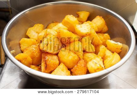 Fried Potatoes With A Golden Crust In A Deep Fryer, Rustic Slices, Lobule
