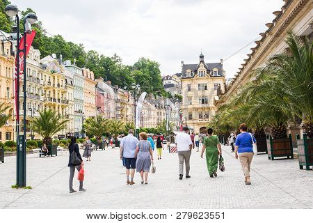 Karlovy Vary, Czech Republic - June 13, 2017: The People Walking On At Center With Facades Of Old Bu