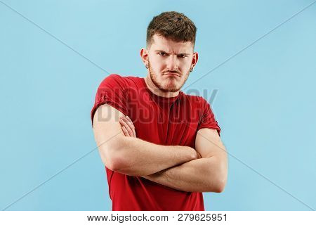 The Sad Emotional Angry Man Screaming On Blue Studio Background. Emotional, Young Face. Male Half-le