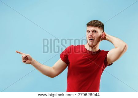 Ew. Its so gross. Young man with disgusted expression repulsing something. Disgust concept. Young emotional man. Human emotions, facial expression concept. Studio. Isolated on trendy blue color poster