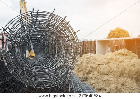 Rolls Of Wire Mesh Steel For Construction Put A Pile On The Ground, Against Construction Site Backgr