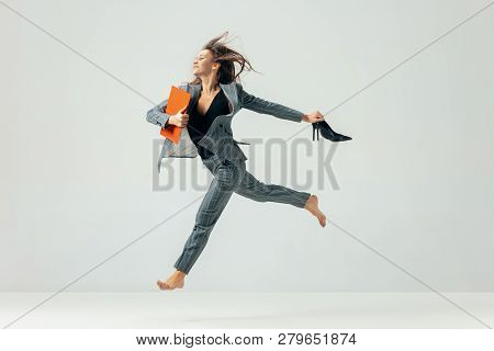 Happy Business Woman Dancing And Smiling In Motion Isolated Over White Studio Background. Human Emot