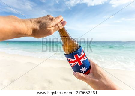 Crack Open A Cold Beer On The Beach On A Warm Sunny Summer Day.  Chilling Out.  Beer Bottle In Coole