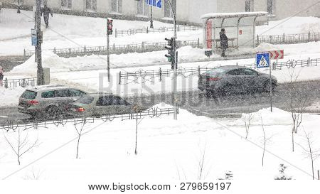 City Traffic In Winter Time. Timelapse Of Car Traffic On The Road During Snow Storm In Winter City.