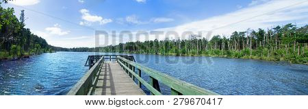 Wooden pier on the shore of the lake.