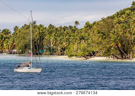 View Of A Boat Docked Next To A Beautiful Island Of Moorea In French Polynesia