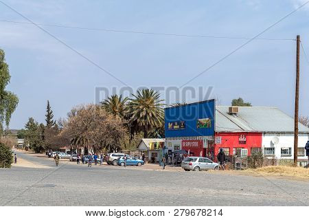 Hopetown, South Africa, September 1, 2018: A Street Scene, With A Supermarket, Vehicles And People,