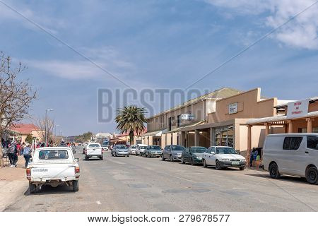 Hopetown, South Africa, September 1, 2018: A Street Scene, With Businesses, Vehicles And People, In