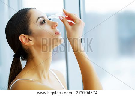 Health And Beauty. Beautiful Young Girl With Eye Drops. Woman Holds Eye Drops In The Hand. Healthy L