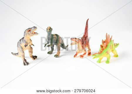 Plastice Dinosaurs Toys On White Background, Idea For Kids  To Play Andwill Enjoy Hours Of Imaginati