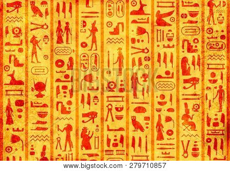 Grunge background with old paper texture of yellow color and ancient egyptian hieroglyphs and symbols
