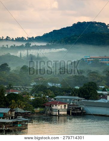 View of Coxen Hole and port on Roatan in morning mist.
