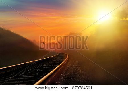 Railroad Against Beautiful Sky At Sunset. Industrial Landscape With Railway Station, Colorful Blue S