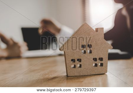 Real Estate Broker Manager Giving Keys To Customer After Signing Contract For Buying House In Estate