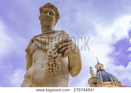 Statue Of Dionysus Or Bacchus With Bunch Of Grapes