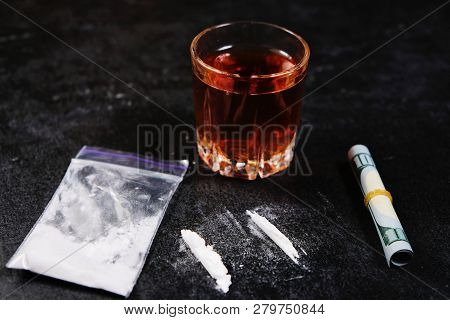 Cocaine, Alcohol And One Hundred Dollars On Black Background.