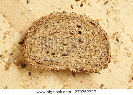 Slice Of Multigrain Bread On Wooden Surface