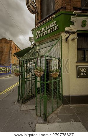 Entrance To Sunflower Public House In Belfast With Safety Cage