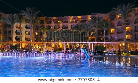 Hurghada / Egypt. 27 July 2018: Swimming Pool And Evening Hotel On Vacation. People Relax In Evening