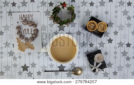 Yuletide Celebration Staff And Postcard. Coffee And Presents On Star Background
