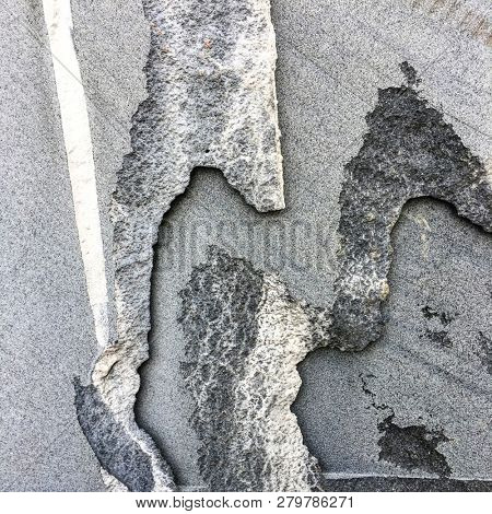 Layers of black roc or untreated granite slabs. Abstract shapes of unpolished and rough cut edges of granite or rock. poster