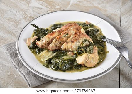 High Angle View Of A Plate Of Gourmet Chicken Florentine