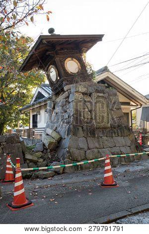 Kumamoto, Japan - November 13, 2018: Broken stone lantern at the Honmyo-ji Temple after the earth quake in 2016