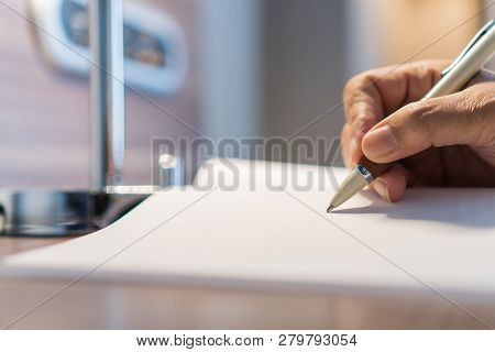 Document Report And Business Busy Concept: Businessman Manager Hands Holding Pen For Checking And Si