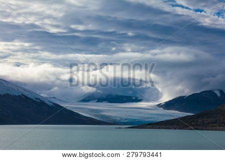 Dramatic sky over the Austdalsbreen glacier and Styggevatnet glacial lake, Jostedalsbreen National Park, Sogn og Fjordane, Norway, Scandinavia