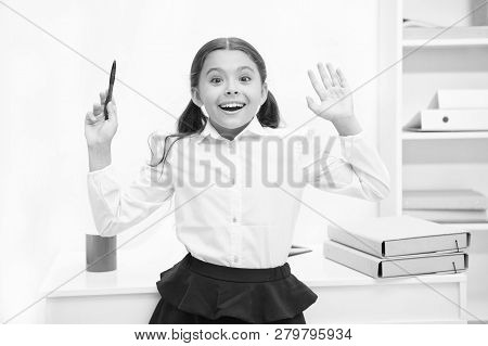 She Knows Right Answer. Child Girl Wears School Uniform Standing Excited Face Expression. Schoolgirl