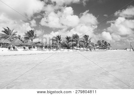 Costa Maya, Mexico - February 01, 2016: Sea Beach. Blue Water, White Sand And Palms On Tropical Sea