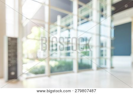 Blur Hotel Or Office Lobby Background Interior View Toward Reception Hall, Modern Luxury White Room