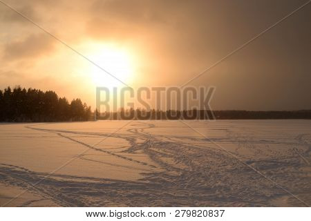 Frozen Lake In The Winter At Sunset In Karelian Isthmus, Russia.