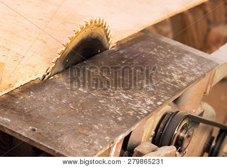 Carpenter Tools On Wooden Table With Sawdust. Circular Saw. Cutting A Wooden Plank