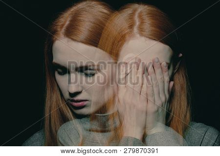 Porter Of Beautiful Redhead Girl With Psychotic Disorders Covering Her Face, Hiding From Her Halluci