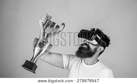 Celebrate Victory. Man Bearded Hipster Vr Headset Holds Golden Goblet. Feel Victory In Virtual Reali
