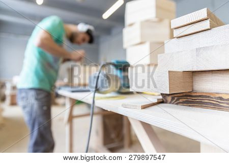 A Man Is Processing A Tree. Joiner. A Carpenter. Woodworking Processes