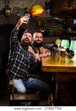 Take Selfie Photo To Remember Great Evening In Pub. Online Communication. Man Bearded Hipster Hold S