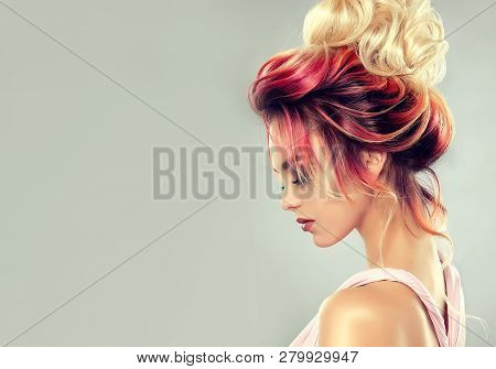 Beautiful Model Girl  With Elegant  Multi Colored Hairstyle . Stylish Woman With Fashion  Hair  Colo
