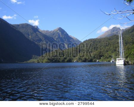 Boat On Lake With Mountains